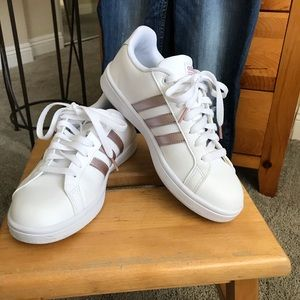 White and rose gold Adidas sneakers